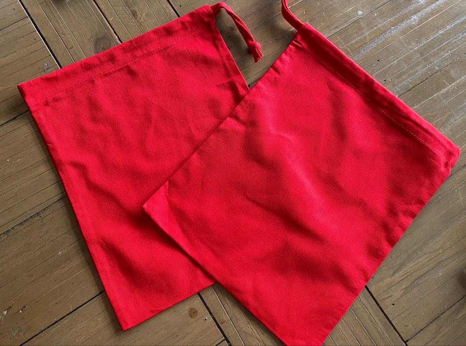 the image shows two small red fabric bags