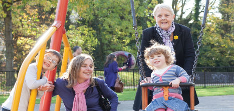 Older woman in park with family