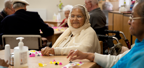Volunteer with older people at Age UK Barnet activity