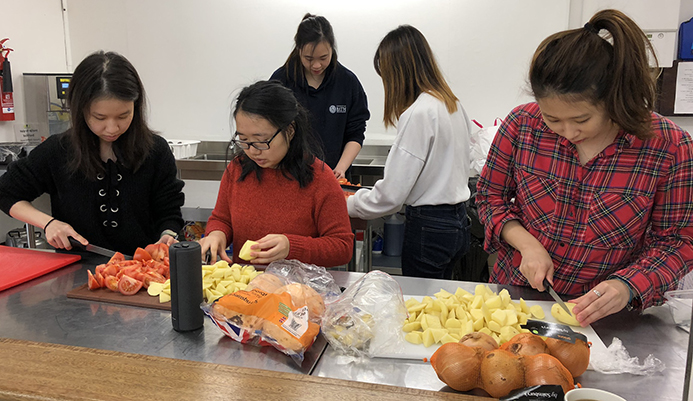 Students make Chinese New Year meal