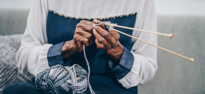 elderly woman knitting