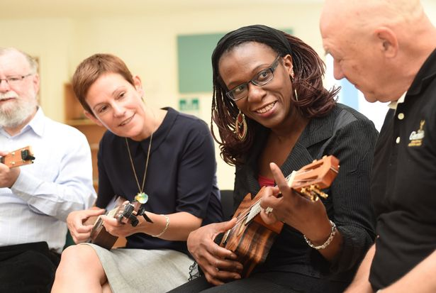 people playing ukuleles in a group