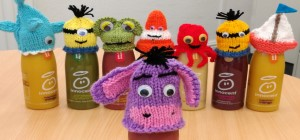 knitted hats on bottles