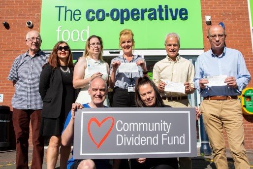 Receiving the cheque from the co-op