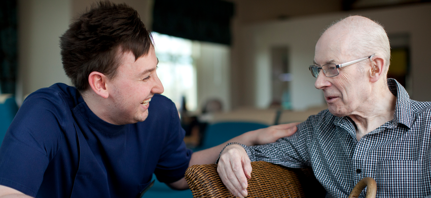 Male carer sharing a joke with male client