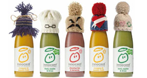 Innocent smoothie bottles with little knitted hats on