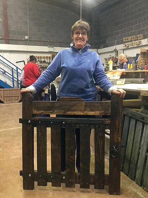 One of the women with a lovely garden gate she has made