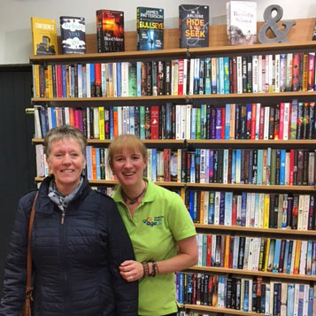 A member of staff and customer both smile for the camera in our Market Harborough Book Shop