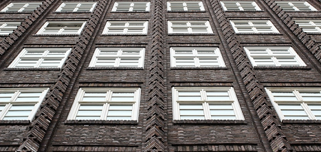 A row of windows of a block of flats.