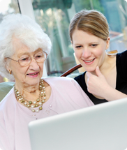Image of 2 women looking at computer