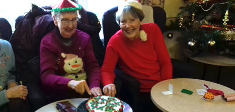 Cutting the dementia support group's Christmas cake