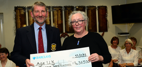 Les Lewis presenting a cheque to Heather Osborne