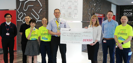 Simon Cope and fellow DENSO staff present a cheque to Catherine McCloy of Age UK Shropshire Telford & Wrekin