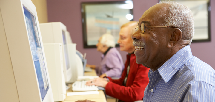Older people at a computer class