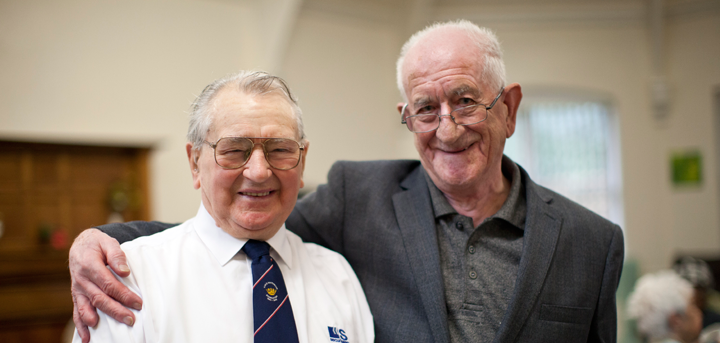 An older man with dementia and his carer