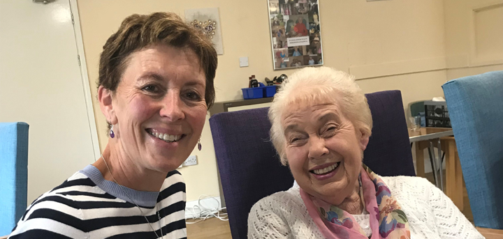 Volunteer and member enjoying a day at an Age UK Shropshire Telford & Wrekin day centre.