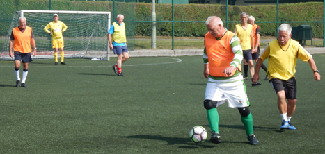 Older men playing walking football