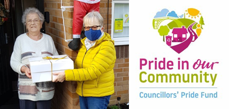 Volunteer Lynne delivering a parcel to a day centre member