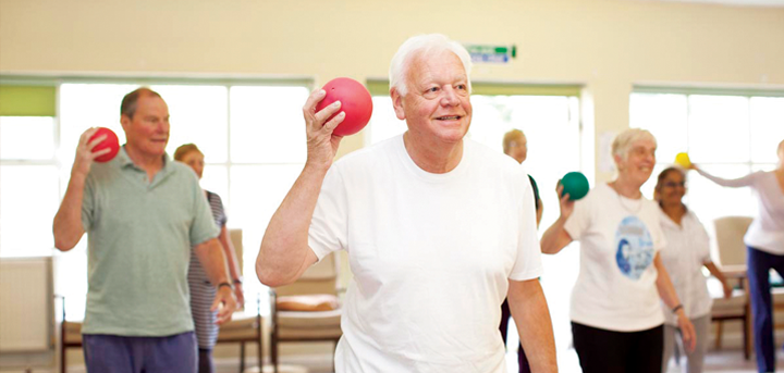 Older people enjoying an exercise class