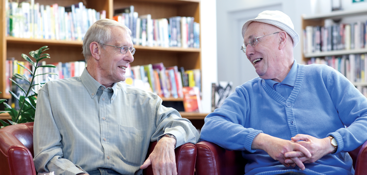 Two men socialising at a reading group