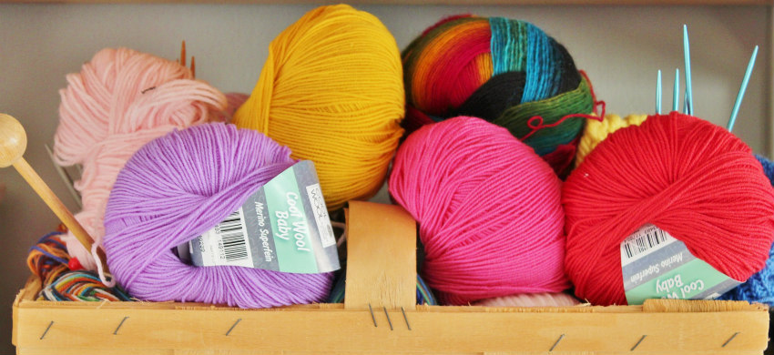 Box of wool and knitting needles
