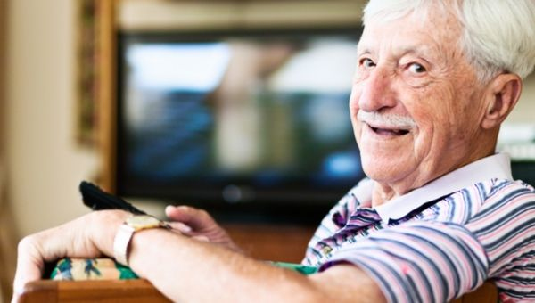 Older man watching TV