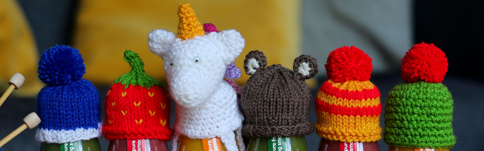A line of innocent smoothies wearing little woolly hats