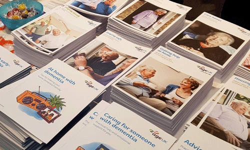 Age UK information guides laid out at the Alzheimer's Show