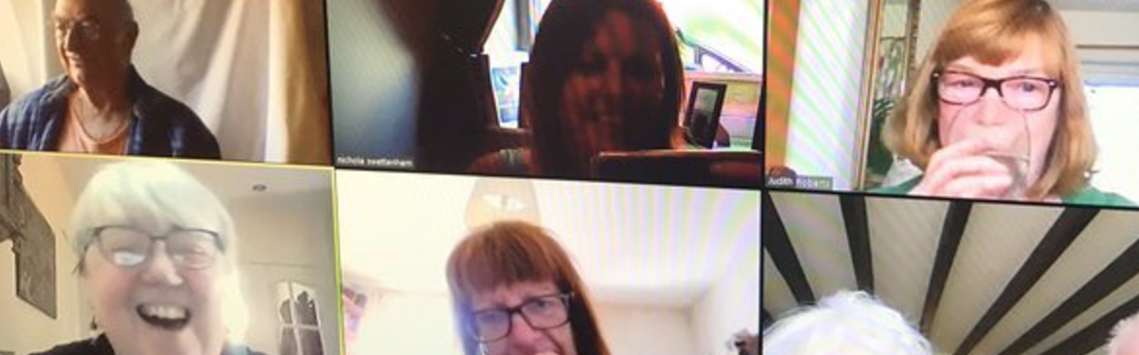 A group of older people speaking on a video call