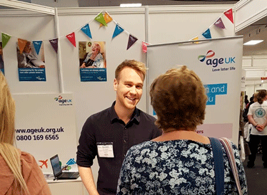 Age UK staff talking to people at the Alzheimer's Show