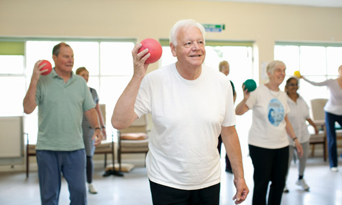 Older adults taking part in an exercise class at Age UK Barnet