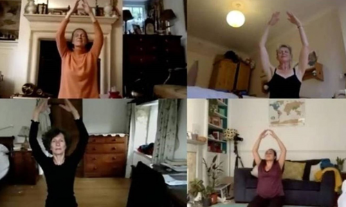 An image of several older women participating in an online dance class