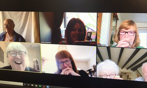 A group of older people talking on a video call