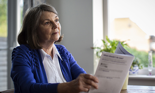 Woman reading through the options of leaving gifts in her will