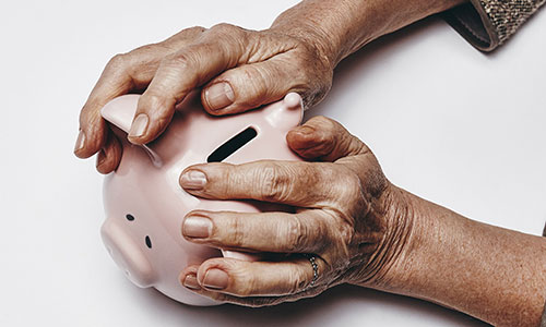 Hands on piggybank