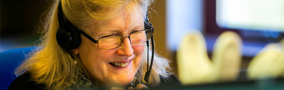 An Age UK adviser answers a call