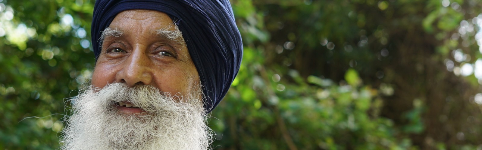 Rajinder, a 73-year-old man of Indian descent known as 'the skipping sikh', smiles at the camera