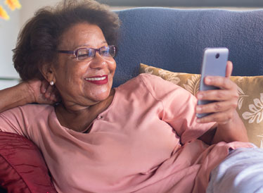 Woman smiling and holding a smartphone
