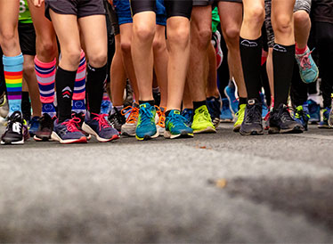 Runners' legs with colourful socks and shoes